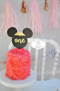Floral Minnie Mouse smash Cake with Rossettes. Party by Smash Cake SoCal Event Planners. Photo credit to Tiffany Nicole Photography